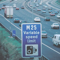 M25 road sign and traffic